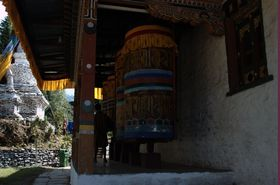 Prayer wheel beside the Nangkor lhakhang