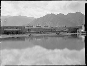 Lhasa during rainy season with Jokhang roof and flooded foreground. Copyright Pitt Rivers Museum, University of Oxford 1998.286.247