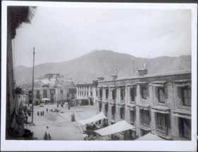 Potala from southwest side of Barkor with Jokhang's Sungchöra (<i>gsung chos ra</i>) square. Copyright Pitt Rivers Museum, University of Oxford 1999.23.1.21.1