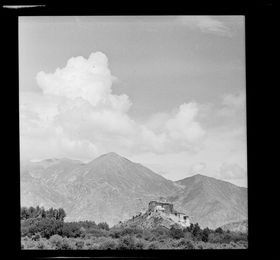 Potala seen at distance from southwest, with forested foreground. Copyright Pitt Rivers Museum, University of Oxford 2001.59.8.5.1