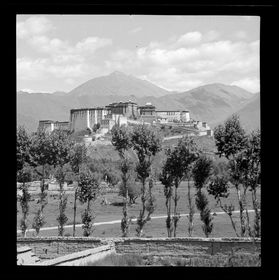 Potala seen from northwest, wall of Lhalu mansion in foreground. Copyright Pitt Rivers Museum, University of Oxford 2001.59.8.6.1